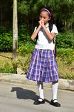 School Girl Praying Wearing Uniform With Books