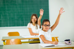 School girl raised hands in class Stock Photography