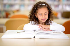 School girl reading a book Stock Image