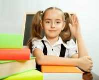 School girl ready to answer for teacher question Stock Photo