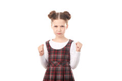 School girl ready to fight. Portrait of displeased girl in school uniform ready to fight against white background royalty free stock photo