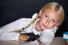 School girl resting on desk Stock Photo