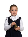 School girl ringing a golden bell. Young school girl ringing a golden bell on white background Royalty Free Stock Photos