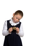 School girl ringing a golden bell. Young school girl looking to golden bell on white background Stock Images