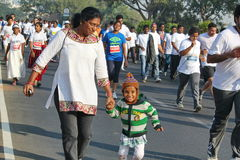 School girl running at Hyderabad 10K Run Event, India Royalty Free Stock Photography