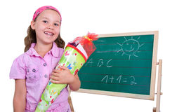 School girl with school cone Royalty Free Stock Images