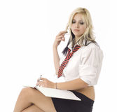 School girl or secretary sitting looking down Royalty Free Stock Images