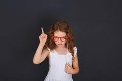 School girl showing finger up stock image