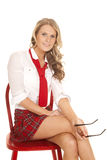 School girl sit red chair hold glasses smile Royalty Free Stock Images