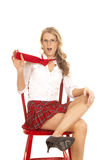 School girl sit red skirt pull tie Stock Images