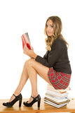 School girl sit on stack of books reading Stock Photos
