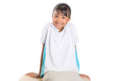 School Girl Sitting On Couch I Stock Photos