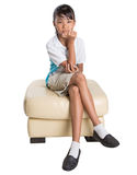 School Girl Sitting On Couch II Royalty Free Stock Images