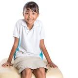 School Girl Sitting On Couch III Stock Photo