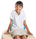 School Girl Sitting On Couch IV Stock Image