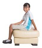 School Girl Sitting On Couch IX Stock Image