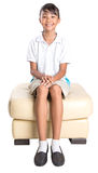 School Girl Sitting On Couch VIII Royalty Free Stock Photos