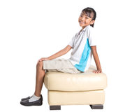 School Girl Sitting On Couch X Royalty Free Stock Photography