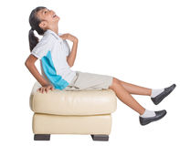 School Girl Sitting On Couch XIII Royalty Free Stock Photography