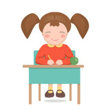 School girl sitting at the desk isolated Royalty Free Stock Photography