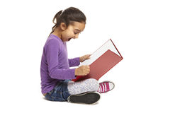 School girl sitting reading book Royalty Free Stock Image