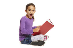 School girl sitting reading book Stock Photography