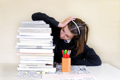 School girl with stack of homework Royalty Free Stock Photography