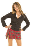 School girl stand in skirt hands on hips Royalty Free Stock Photography