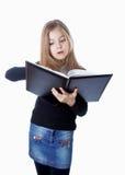 School girl standing with blank book in hands Stock Photos