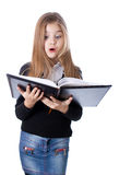 School girl standing with blank book in hands Stock Photos