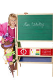 School girl stands happy beside chalk board Royalty Free Stock Photo