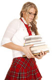 School girl struggle to hold books Stock Photos