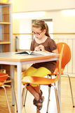 School girl studying in library Stock Image