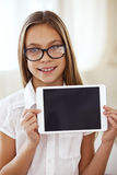 School girl with tablet pc Stock Images