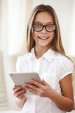 School girl with tablet pc Stock Photos