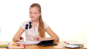 School girl taught lessons using the tablet stock video