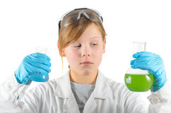 School girl with test tubes Stock Images