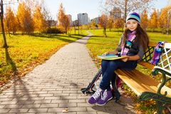 School girl with textbooks in the park Stock Images