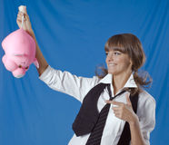School girl with thr toy in a hand. School girl with the toy in a hand on blue background Royalty Free Stock Photography