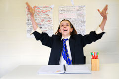 School girl throwing paper in air Royalty Free Stock Photography