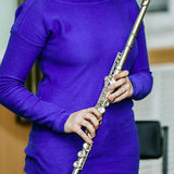 School girl with transversal flute Royalty Free Stock Image