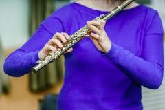 School girl with transversal flute Stock Photos
