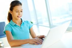 School girl typing Royalty Free Stock Photography