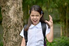 School Girl Under Stress Wearing School Uniform. An attractive and asian person stock photo