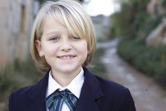 School girl in uniform. A school girl dressed in a Brittish school uniform blazer and bow tie stock images