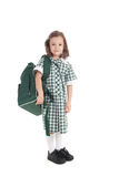 School girl in uniform with bag. Primary school girl in uniform with school bag over shoulder. Isolated on white Stock Images