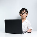 School girl using laptop Royalty Free Stock Photography