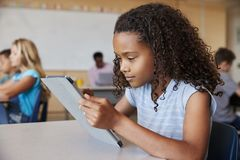 School girl using tablet in elementary school class close up stock image