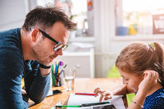 School girl using tablet to finish homework royalty free stock image