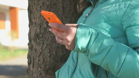 School girl views her photos using a cellphone stock footage